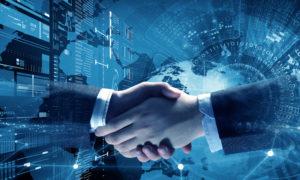 Close up of business handshake on digital technology background
